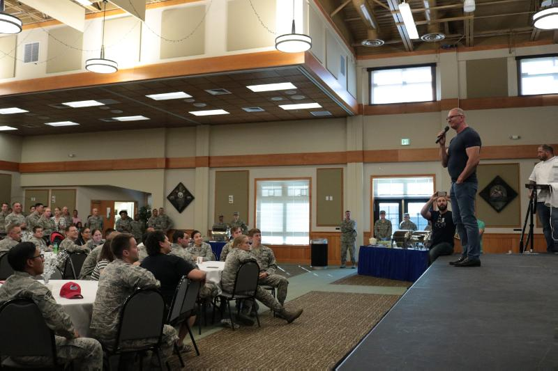 6/54: Guest speaker talks to an audience of service members