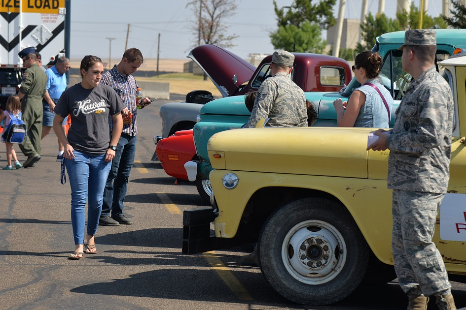 30/54: Woman looks at automobiles at a car show